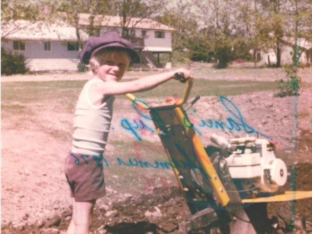Five year old Dr. Erikson preparing the soil.