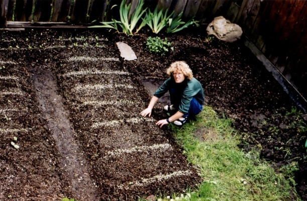 Dr. Erikson planting veggie garden during his years studying Chinese medicine